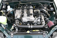 M62 mounted opposite intake manifold on Mazda