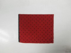 Perforated red Alcantara